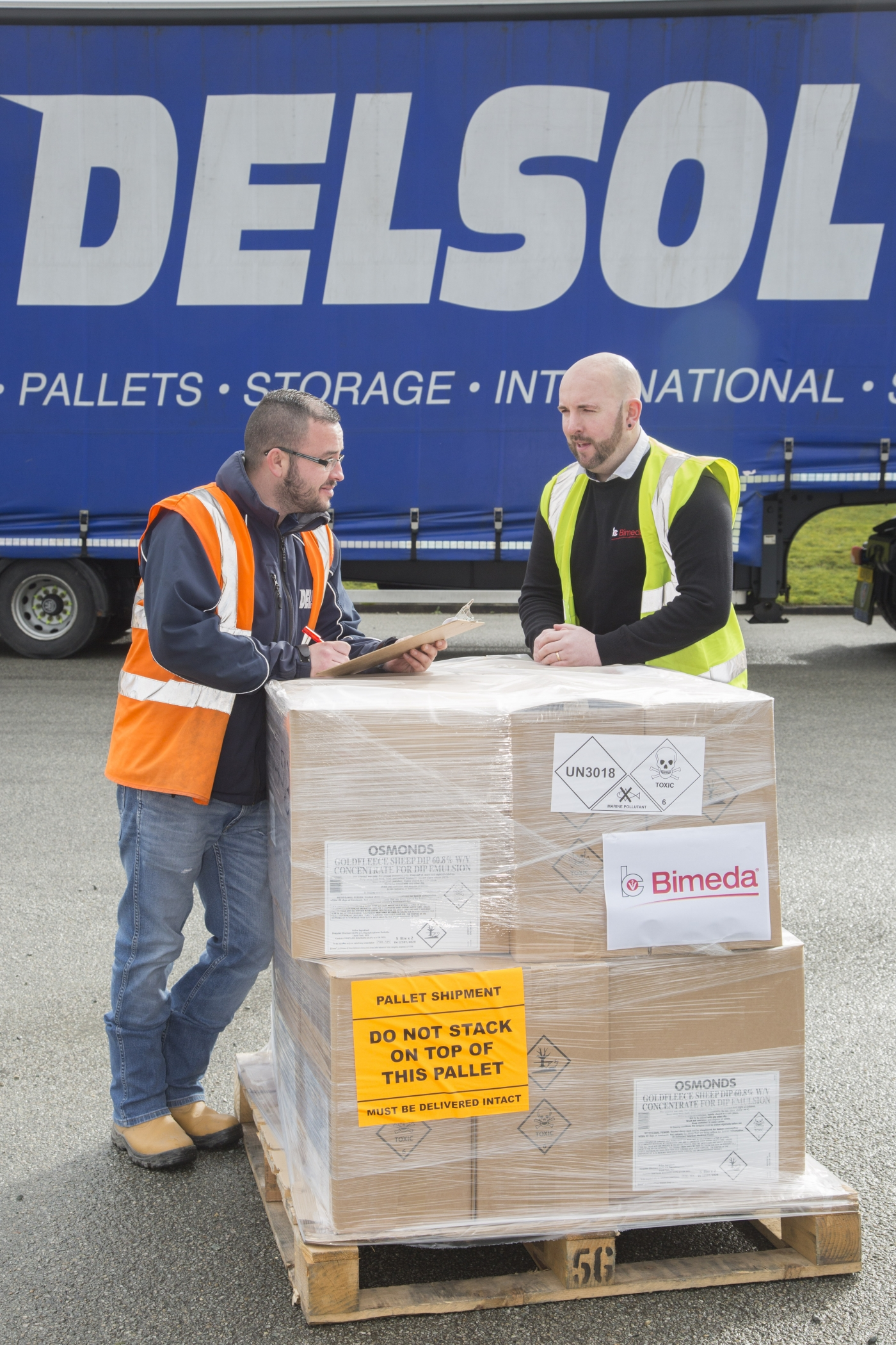 Delsol driver taking delivery of items from Bimeda, which are distributed under Delsol's Hazchem licence.  Pictured is Delsol driver Paul Kavanagh with Steve Jones warehouse supervisor at Bimeda , Llangefni.